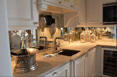 Mirrored Backsplash in White Kitchen. Love!!