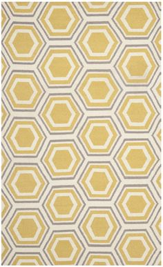 Features:  -Material: Wool pile.  -Flat woven technique.  -Handmade.  Technique: -Flat woven.  Product Type: -Area Rug.  Primary Color: -Ivory.  Material: -Wool. Dimensions:  Overall Product Weight: -