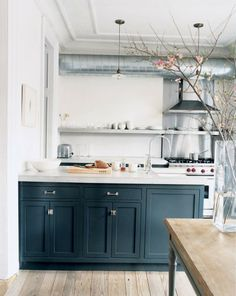 Jenna Lyons likes how the thick  poured-concrete countertops  absorb wine stains, giving the  kitchen a lived-in quality | domino.com