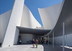 Curls of white concrete and a water-filled courtyard surround this museum of Baroque art and culture in Mexico by Japanese architect Toyo Ito
