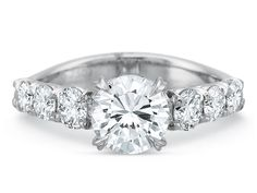Collection: Silk Style: 2402 Metal: 18K White Gold Description: Silk Six Round Diamond Shank Engagement Ring Diamond Weight: 0.80ct Available Metal: 18K and Platinum