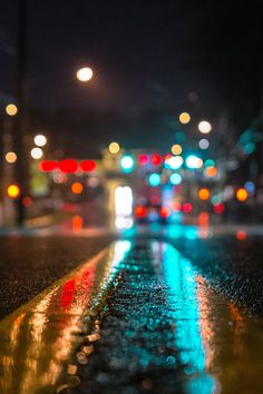 Colours, reflected on a wet street surface.