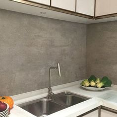 Persian grey stone effect large format porcelain tiles used for a modern kitchen splashback