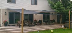 Grey shade sail, with pressure treated posts Sun Sail Shade, Sailing, Pergola, Deck, Shades, Outdoor Structures, Posts, Grey, Outdoor Decor