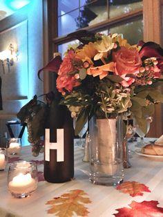 Head table centerpiece with brides bouquet