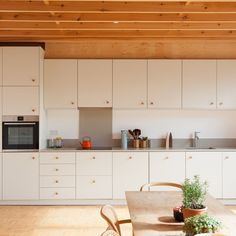 "The Modern House on Instagram: ""#forsale Mews Makeover: a former furniture workshop in east London, transformed by architects @matheson_whiteley. Head to the link in our…"" Open Plan Kitchen, Kitchen Dining, Minimal Kitchen Design, Country Modern Home, Plywood Cabinets, Glass Storage Jars, Open Plan Living, Victorian Homes, Living Spaces"