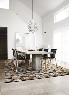 This rug brings your attention to the dining area.