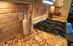 Subway style brick backsplash with warm granite countertops are a perfect combination. www.jamesriverconstruction.com