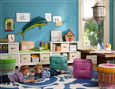 Blue Playroom With White Storage Bench And Blue White Carpet Under Beanbags