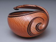 Leon Lacoursiere - gorgeous wood piece, love the swirls, the way the tip reaches, continuing the swirl...