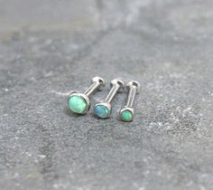 Green Opal Triple Helix ,Triple Forward Helix, Flat Back Surgical Steel Internally Thread Piercing Jewelry 16G 18G, Helix Earring Studs by Purityjewel on Etsy https://www.etsy.com/listing/232886622/green-opal-triple-helix-triple-forward