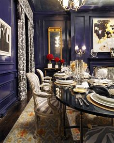 """""""The high-gloss, midnight-blue walls in this dining room that we designed in a Manhattan townhouse reflect yet absorb light,"""" New York designer Eric Cohler.   - ELLEDecor.com"""