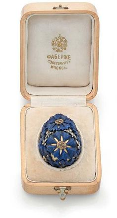 Karl Faberge. Egg chased gold sets of lapis lazuli into stars and rose cut diamonds. In the box marked Faberge, St. Petersburg Moscow