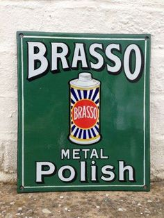 A Brasso Metal Polish pictorial enamel sign