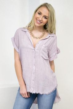 """This lilac shirt screams summer loving. This button up top features short sleeves, fringed ends, and a front pocket. Stay cool in this top with skinny denim. Model is 5'5"""", and she is wearing a size S"""