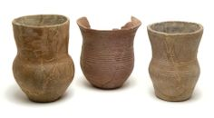 Bronze Age pottery beakers found inside Wick Barrow in 1907.  They can be seen on display in the Museum of Somerset, Taunton.