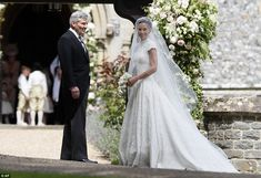 Pippa Middleton arrives with her father Michael Middleton for her wedding to James Matthew...