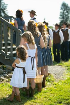 I like the white dresses for my flower girls and also with the boots.