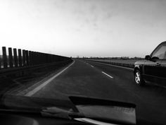 Grayscale Photography of Car on Road  Free Stock Photo
