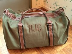 Exactly as pictured. Green bag, brown letters, and block monogram (ANT)