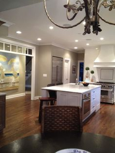 White Kitchen, sand-colored walls, wood floor