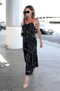 Victoria Beckham keeps it classy in a silk spaghetti strap dress