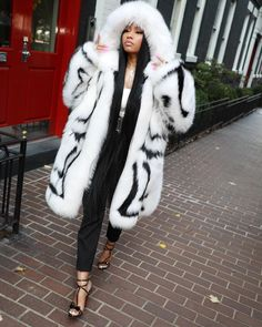53ffd9bcbb92d Spott - Nicki Minaj wearing an oversized fur coat by Oscar de la Renta