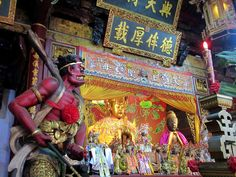 A guardian demon watches over a gilded statue of the Chinese sea goddess Mazu at the Grand Mazu Temple in Tainan, Taiwan. Sun Moon Lake, Taiwan Travel, Taipei, Asia, Statue, Temple, Travelling, Chinese, Watches