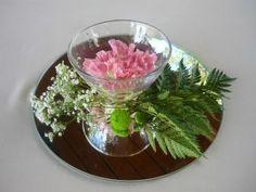 Espejos, agua y flores, genial.