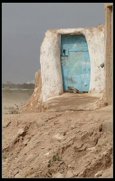 somewhere in Morocco, there's a door and behind that door, people laze about the tide lapping across their feet/finish the story if you please...story started by ceeanne lei.