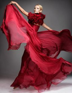 Not sure about that top, but I love the flowing skirts, and the color.