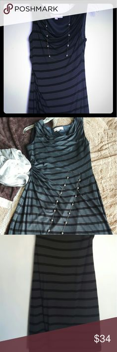 Ann Taylor Loft Black Striped Sleeveless Dress All eyes will be on you in this stunning dress that hugs your body in all the right places. It's in practically new condition. Only worn a couple times. The neckline layers down. Dress cinches on the side. Styled this with a necklace. Necklace not included. LOFT Dresses