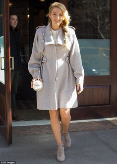 Silver siren: Blake Lively looked gorgeous as she left her New York City hotel on Thursday in a short silver coat