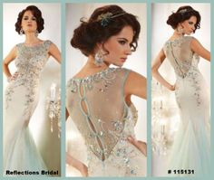 Let us know what you think of this gown.  LOVE the back!!
