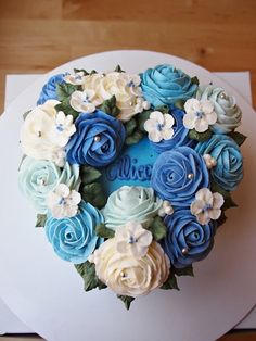 The heart shape blue flower cake.  Made by Alice.