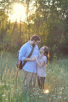 Romantic engagement photography session, field of flowers at sunset.  by Awakened Light Photography