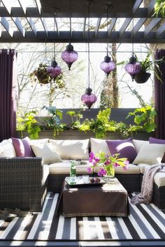 Outdoor lounge with purple accents I'd prefer a different color like red , green, or blue