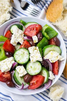 A traditional Greek salad (Horiatiki) is a chunky salad that combines fresh summer produce, salty olives, and creamy goat cheese with a light oil and vinegar dressing for a satisfying summer meal or side dish. #salad #Greek Tasty Dishes, Food Dishes, Green Pepper Recipes, Traditional Greek Salad, Greek Salad Recipes, Greek Dishes, Main Dishes, Summer Tomato, Recipe For Mom