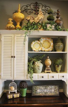 Above cabinet decor, greenery, iron work placement; decorating above kitchen cabinets French Kitchen Decor, French Country Kitchens, French Country Cottage, French Country Style, French Decor, Kitchen Vignettes, Country Hutch, Kitchen Hutch, Kitchen Interior
