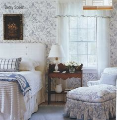Betsy Speert's Blog: A Country Home Bedroom   Love that chair and ottoman that looks like a chaise lounge.  Love the blue and white all over the place!