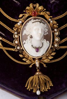 Austrian carved shell, ruby and pearl cameo set.