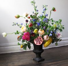 Flowers by Sachi Rose. Wild, organic floral arrangement inspired by Dutch still-life painting.