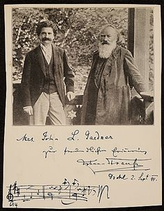 "Johann Strauss, Sohn, and Johannes Brahms. Strauss has signed and dedicated this photo to a Mrs. Gardner, and has added the opening bars to the main theme of the ""Blue Danube"" waltz."
