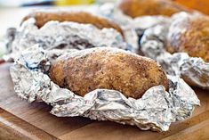 These Baked Potatoes are brushed with butter than seasoned with salt, pepper, and garlic powder. Wrap them in tinfoil and grill them until they are light and fluffy inside! You'll even eat the skins they are so delicious! Grilled Baked Potatoes, Baked Potato Oven, Baked Potato Recipes, Grilling Recipes, Cooking Recipes, Healthy Recipes, Easter Recipes, Summer Recipes, Potatoes In Oven