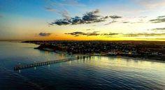 Sunrise at Port Noarlunga jetty, Visit Fleurieu Peninsula Pic: KillaBee.Media