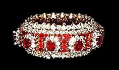 """Imelda's Ruby and Diamond bracelet with ten 5 cts. pigeon blood red rubies surrounded by smaller rubies and diamonds in yellow gold. 1.5 inches wide X 8"""" long Marked Van Cleef & Arpels, NY."""