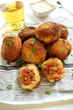 Potato bombas are tasty little stuffed mashed potato balls that you can find in Spanish tapas bars. Stuffed with mushrooms to make a great vegan appetizer.