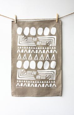 This is a 100% linen tea towel with Leahs Hanna design. It is screen printed with water-based white ink on soft natural linen. It is hemmed on four