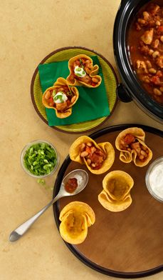 Three-Bite Chicken Chili Cups - Don't serve your chili in a bowl. Instead, try these baked tortilla cups and surprise your guests with an easy and enticing appetizer.