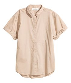 Light beige. Straight-cut shirt in airy, woven cotton fabric with a collar. Concealed buttons at front, dropped shoulders, and short sleeves with sewn cuffs